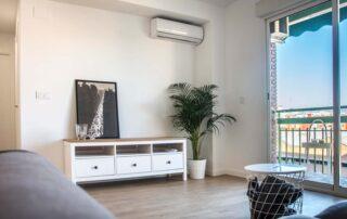 Mueble de salón y acabados en piso reformado en valencia por Construtech
